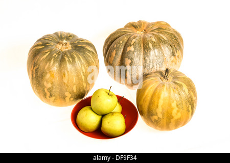 Pumpkins and green apples on a white background, isolated - Stock Photo