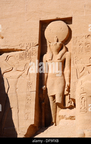 Hawk-headed Ra-Harakhte in niche above entrance - Great Temple of Ramesses II at Abu Simbel, Upper Egypt - Stock Photo