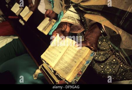 Herero women with prayer books during black service in Swakopmund. Namibia - Stock Photo