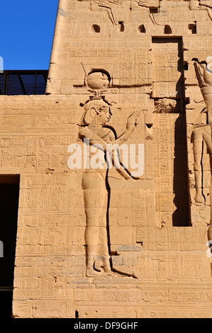 Wall relief on Second Pylon of Temple of Isis at Philae Island - Aswan, Upper Egypt - Stock Photo