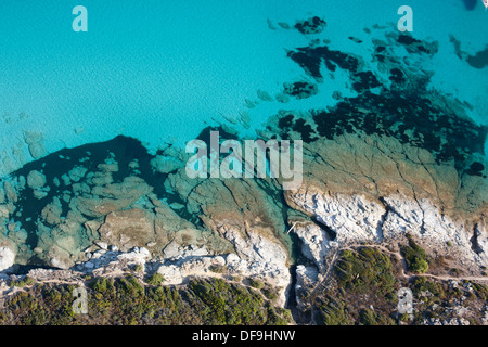 DÉSERT DES AGRIATES SHORELINE (aerial view). Crystal clear water of the rocky coast near the city of Saint-Florent, - Stock Photo
