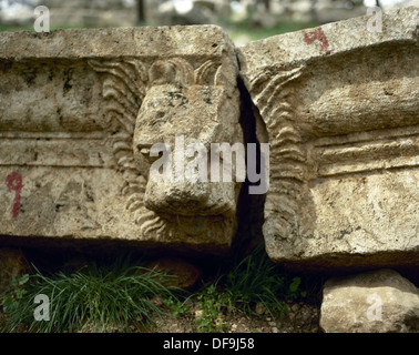 Basilica of Saint Simeon Stylites. 5th century. Sculptural detail depicting a head of a lion. Near Aleppo. Syria. - Stock Photo