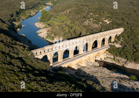 ROMAN AQUEDUCT BRIDGE (aerial view). On the UNESCO world heritage list. Pont du Gard, Languedoc-Roussillon, France. - Stock Photo