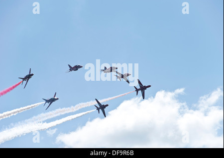 The RAF Red Arrows display team performing a manoeuvre at the Dawlish Air Show, August 2013 - Stock Photo