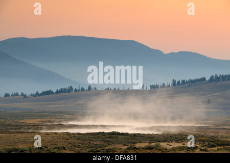 Blacktail Lakes with morning mists, Yellowstone NP, Wyoming, USA - Stock Photo