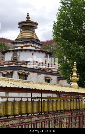 Prayer wheel wall and top of Kumbum Chörten, Pelkor Chöde, Palcho monastery, Gyantse, Tibet - Stock Photo