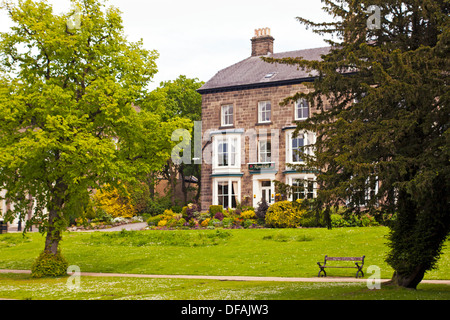 Victorian Guest Houses on Broad Walk in Pavilion Gardens, Buxton - Stock Photo