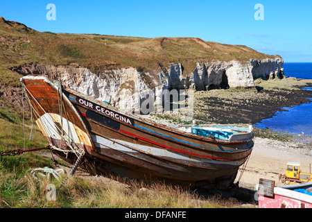 An old fishing boat in North Landing at Flamborough Head, East Yorkshire, England, UK. - Stock Photo
