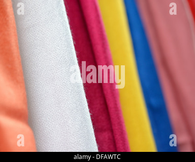 Scarves of different colors sold on street market - Stock Photo