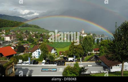 Rainbow over Spiez on Lake Thun, Switzerland - Stock Photo
