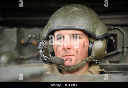 British Army Tank driver with reserve units training with the full time regular regiments, in this case the Royal - Stock Photo