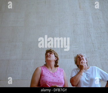 Two women gaze at the names of war dead at the Thiepval Memorial, the largest British war memorial in the world - Stock Photo