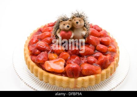 Fresh strawberry cakes with hedgehog pair - Stock Photo