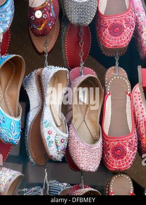 Traditional leather Shoes on display outside a shop  Pune, Maharashtra, India - Stock Photo