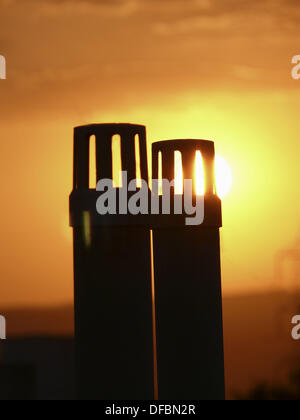 Sunset against drain pipes  Pune, Maharashtra, India - Stock Photo