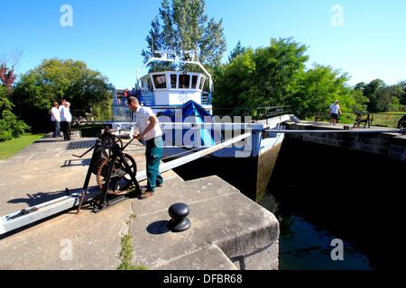 a tour cruise ship going through the locks on the Rideau Canal at Smith Falls Ontario Canada - Stock Photo