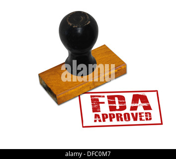 An office rubber stamp with text 'FDA Approved' punched in red - Stock Photo