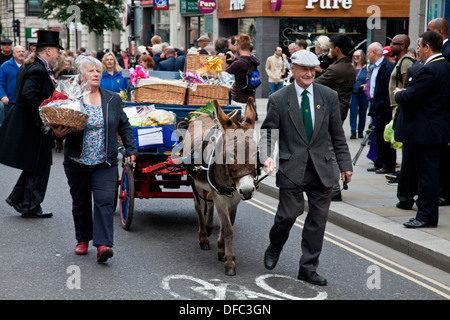 Donkey and Cart in The Pearly Kings and Queens Harvest Festival Parade, London, England - Stock Photo