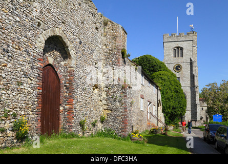 St Peter and St Paul church, couple walking by the ruins of the Archbishop's Palace, Charing Kent UK - Stock Photo
