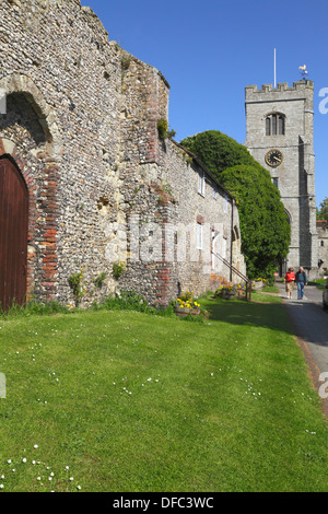 St Peter and St Paul church, couple walking by the ruins of the old Archbishop's Palace, Charing, Kent, UK - Stock Photo