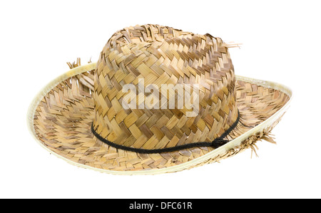 Side view of an old woven straw hat with the straw parting from the brim on a white background. - Stock Photo