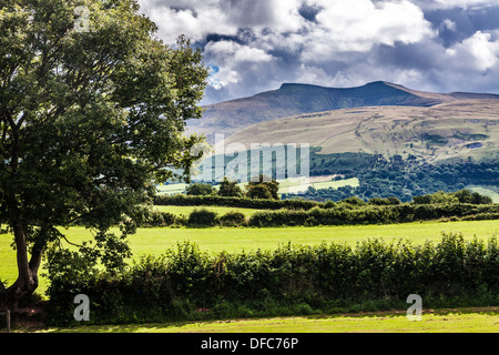A stormy, showery summer's day in the Brecon Beacons National Park, Wales looking towards Pen y Fan and Corn Du. - Stock Photo