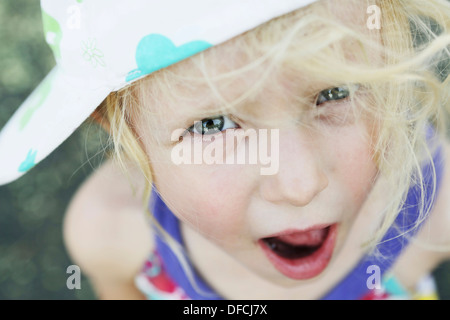 Germany, North Rhine Westphalia, Cologne, Portrait of girl with cap, close up - Stock Photo