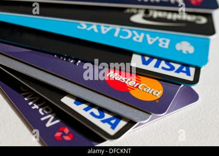 Close up various selection of Mastercard Barclays Barclaycard Visa Natwest plastic bank credit cards card