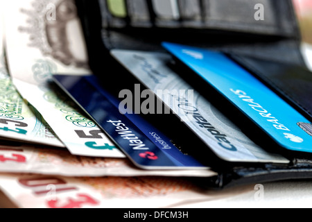 Close up of leather wallet showing bank notes and credit cards - Stock Photo