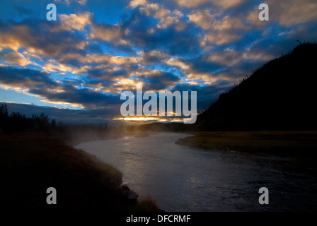 Yellowstone National Park with Steam Rising from the Madison River in Early Morning - Stock Photo