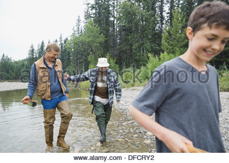 Male family members fishing together - Stock Photo
