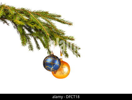 Blue and yellow Christmas toys on the fir-tree on white background - Stock Photo