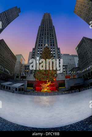 The Rockefeller Center Christmas tree at the skating rink during the twilight hour in New York City. - Stock Photo