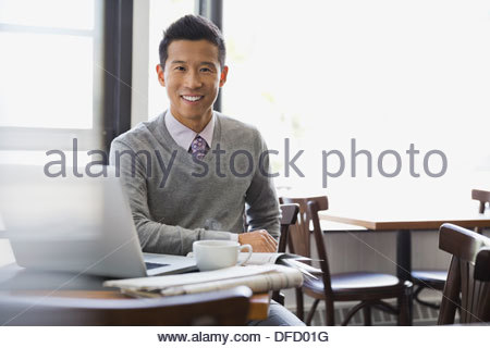 Portrait of businessman sitting at restaurant table - Stock Photo