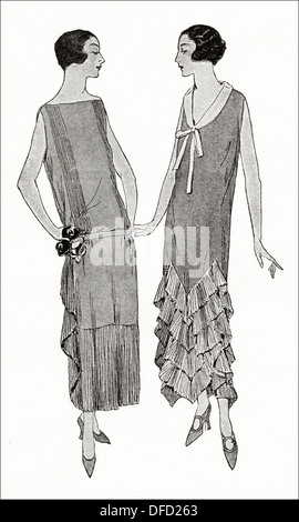 Flapper fashion of the 1920s. Grey crepe de Chine in these two frocks with pleated frill and flounce, designer unknown. - Stock Photo