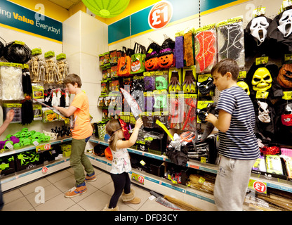 Children playing with halloween toys, Poundland store interior, Norwich norfolk UK - Stock Photo