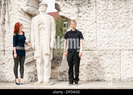 Hungarian man and woman visiting Memento Statue Park in Budapest, Hungary - Stock Photo