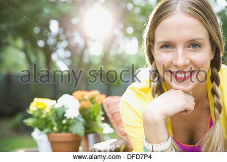 Portrait of beautiful woman in yard - Stock Photo