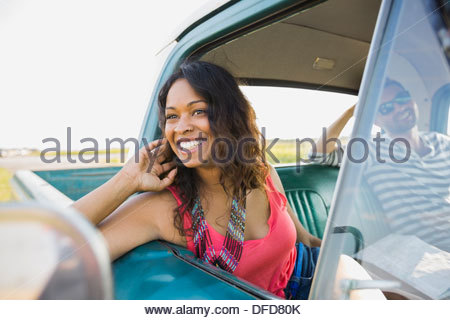 Woman looking out from window of pick-up truck - Stock Photo