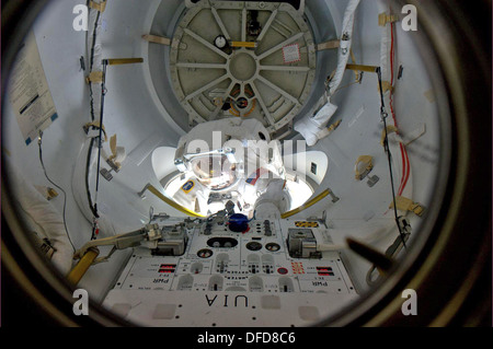 Emerging from the Quest airlock on the International Space Station, astronaut Alvin Drew began his shared spacewalking - Stock Photo