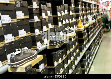 3dd33c9924ce Converse shoes arranged on shelves in Converse shoe shop