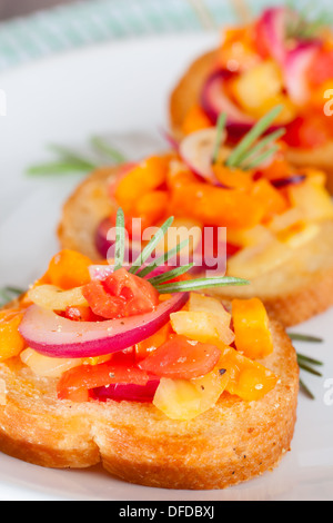 Bruschetta with fresh tomatoes and red onion - Stock Photo