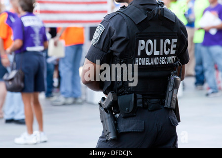 US Homeland Security (Federal Protective Service) policeman monitoring a demonstration - Washington, DC USA - Stock Photo