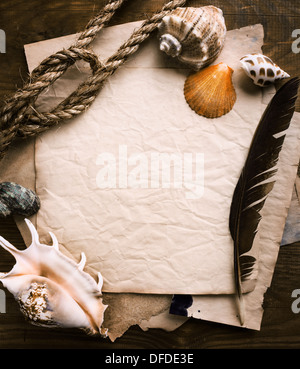 old paper on brown aged wood - Stock Photo