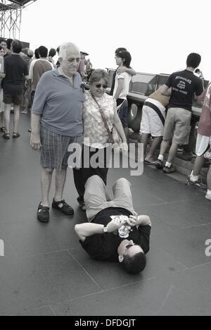 Taking a ouvenir picture on the top of the Corcovado, Rio de Janeiro, Brazil - Stock Photo