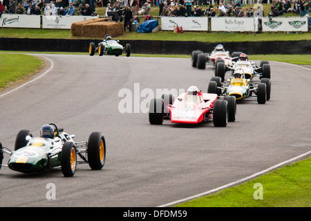 Parade  of Lotus cars Raced By Jim Clark Goodwood Revival - Stock Photo