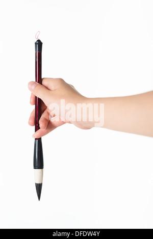writing brush in man's hand - Stock Photo