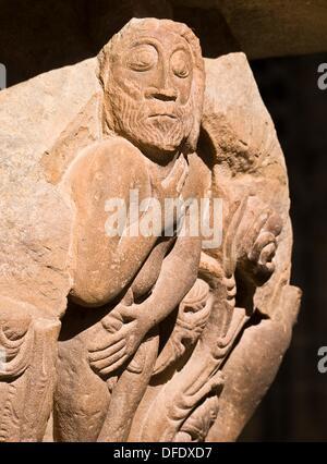 Representación de Adán en un capitel del claustro del Monasterio de San Juan de la Peña, de estilo románico - Jacetania - Stock Photo