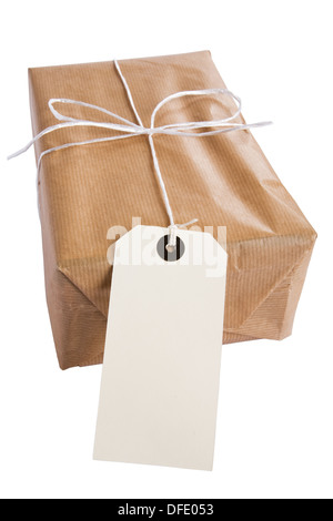 Blank address label on brown paper parcel. - Stock Photo