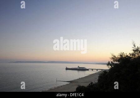 View down from East Cliff to Beach and Pier at sunset Bournemouth Dorset England - Stock Photo